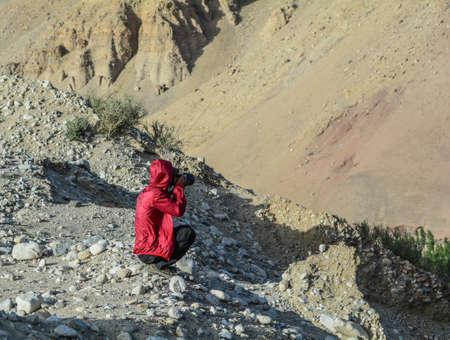 Asian traveler enjoying on mountain in Ladakh, State of Jammu & Kashmir, northern India.