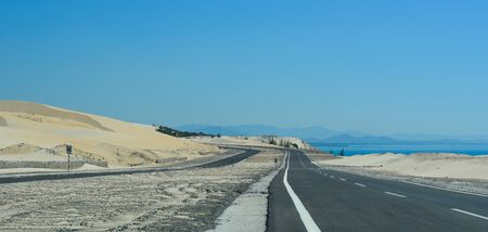 Highway at summer day in Phan Thiet, Vietnam. The total length of the Vietnam road system is about 222,179 km. 스톡 콘텐츠