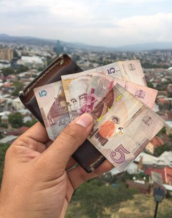 Georgian paper money with Tbilisi cityscape background. The lari is the currency of Georgia.