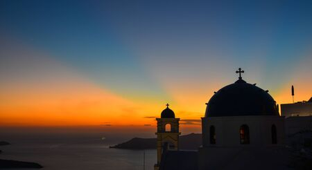 Orthodox church at sunset on Santorini Island, Greece. Santorini is one of the most popular islands in the world.