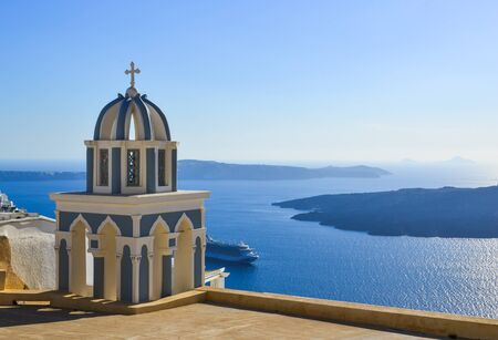 Orthodox church on Santorini Island, Greece. Santorini is one of the most popular islands in the world. Imagens