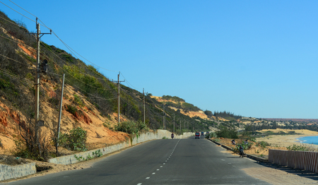 Highway at summer day in Phan Thiet, Vietnam. The total length of the Vietnam road system is about 222,179 km. 에디토리얼