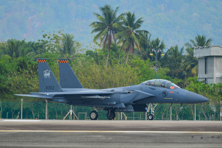 Langkawi, Malaysia - Apr 1, 2019. A McDonnell Douglas F-15SG Eagle fighter aircraft of Singapore Air Force (RSAF) taxiing on runway of Langkawi Airport, Malaysia.