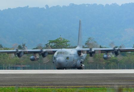 Langkawi, Malaysia - Mar 31, 2019. Lockheed C-130H Hercules Royal Malaysian Air Force (TUDM M30-08) taxiing on runway of Langkawi Airport (LGK). 報道画像