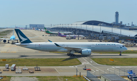 Osaka, Japan - Apr 18, 2019. B-LXF Cathay Pacific A350-1000 taxiing on runway of Kansai Airport (KIX). Kansai is the 3rd busiest in Japan, with 25 million passengers.