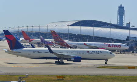 Osaka, Japan - Apr 18, 2019.  Delta Air Lines N1200K (Boeing 767-300ER) taxiing on runway of Kansai Airport (KIX). Kansai is the 3rd busiest in Japan, with 25 million passengers.