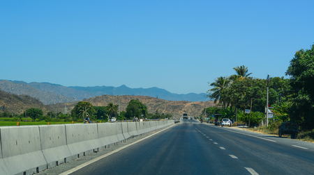 Phan Thiet, Vietnam - Mar 20, 2016. Highway at summer day in Phan Thiet, Vietnam. The total length of the Vietnam road system is about 222,179 km.