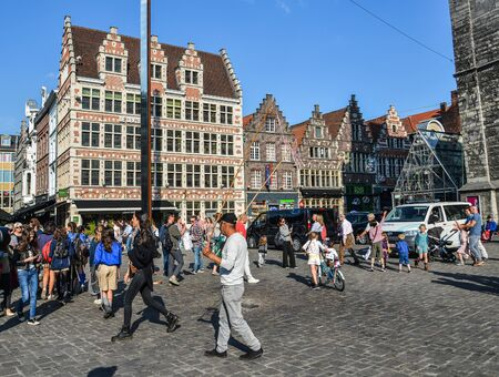 Ghent, Belgium - Oct 6, 2018. Tourists at old town of Ghent, Belgium. Ghent is the Belgium most beautiful city, rich in history, and attracting tourists.