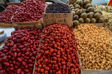 Singapore - Jul 4, 2015. Spices and dried foods for sale at Chinatown local market.