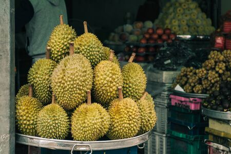 Raw durian fruits for sale at rural market in Mekong Delta, Vietnam.