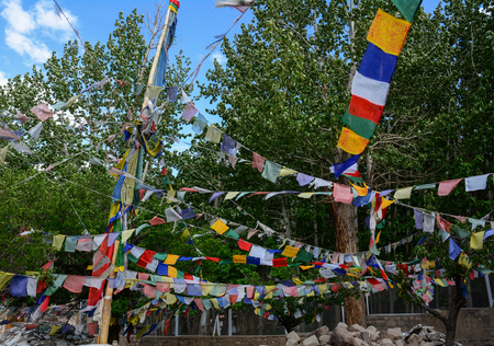 Ladakh, India - Jul 16, 2015. Praying flags at ancient Buddhist temple in Ladakh, India. They are used to bless the surrounding countryside and for other purposes.