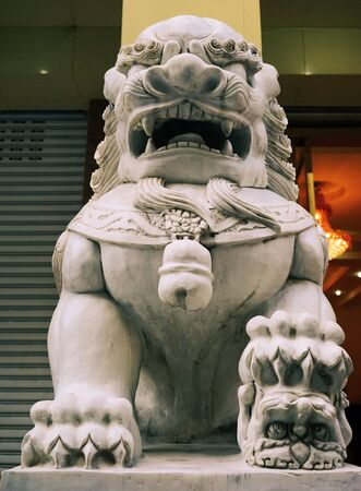 A lion sculpture at an ancient temple in Chengdu, China. Stock Photo
