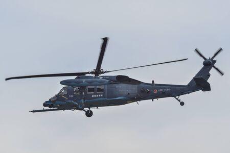 Saitama, Japan - Nov 3, 2019. Sikorsky UH-60J Blackhawk helicopter of Air Self Defence Force (JASDF) flying for display at Iruma Air Base (RJTJ) in Saitama, north of Tokyo, Japan.