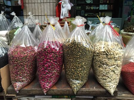 Chengdu, China - Nov 2, 2015. Spices and dried foods for sale at the local market in Chengdu, Sichuan Province, China.