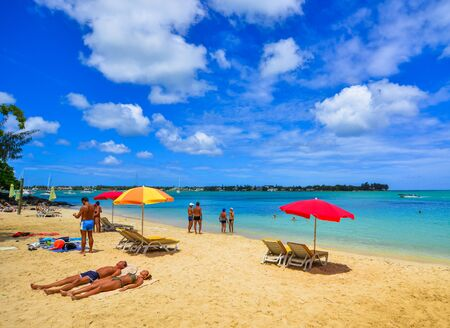 Le Morne, Mauritius - Jan 4, 2017. Colorful umbrella with relaxing chairs on Mauritius Island. Mauritius is one of the best destinations,  known for its beaches, lagoons and reefs. Archivio Fotografico - 137900796