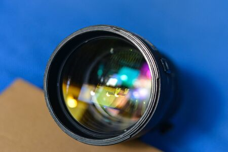 Black ultra telephoto zoom lens for display in the store.