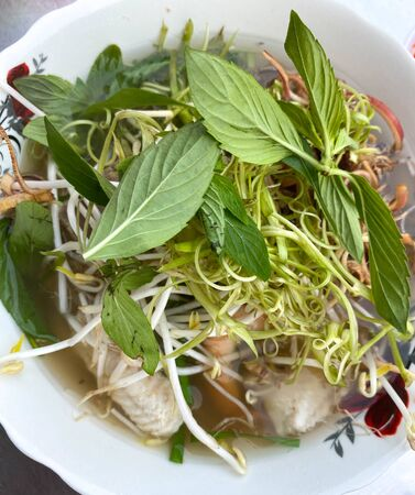 Fish noodle (Bun Nuoc Leo) on white bowl at local restaurant in Mekong Delta, Vietnam. Stock Photo