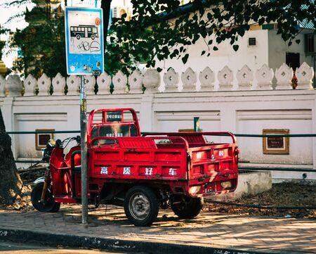 Vientiane, Laos - Jan 29, 2020. Small truck on street in Vientiane, Laos. Vientiane is the capital and largest city of Laos, on the banks of the Mekong River.