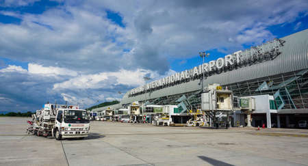 Penang, Malaysia - Aug 20, 2014. Main building of Penang Airport (PEN). The airport also has 64 check-in desks and 11 gates, 12 aerobridges and three luggage claim belts.