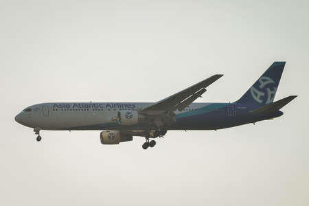 Bangkok, Thailand - Apr 21, 2018. Asia Atlantic Airlines HS-AAB (Boeing 767-300ER) landing at Suvarnabhumi Airport (BKK). BKK is one of the biggest airports in Southeast Asia. 新闻类图片