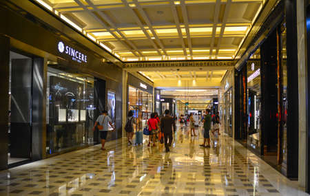 Singapore - Jul 4, 2015. Marina Bay Sands shopping mall interior architecture. The mall is an integrated resort fronting Marina Bay in Singapore.