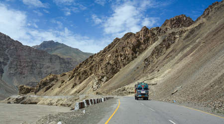Ladakh, India - Jul 16, 2015. Heavy truck runs on mountain road of Ladakh, Northern India. Ladakh is the highest plateau in India with much of it being over 3,000 m.