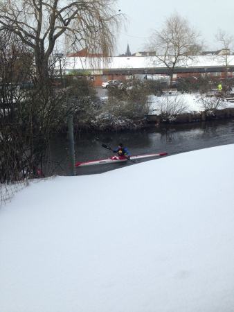 excersise: a man going for a excersise doing the winter in the river