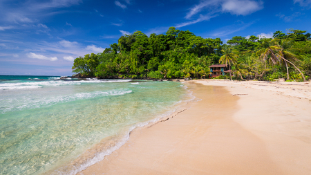 Beautiful tropical Red Frog Beach in Panama with palm trees and beach hut