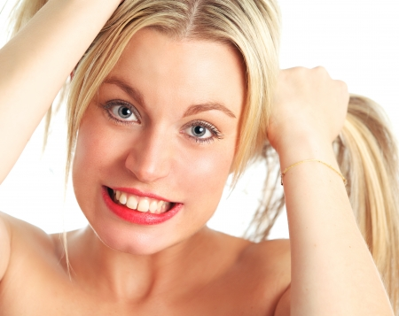 clutching: A beautiful female blonde model pulling her pony tails.