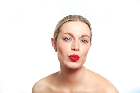 A young female blonde model pouting for the camera.