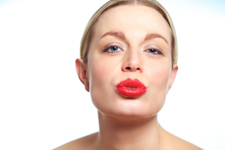 Closeup of a female model puckering her red hot lips.
