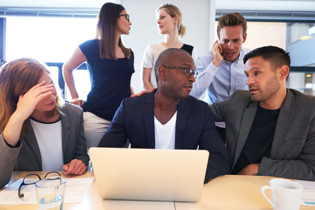 intensely: Group of young executives sitting together working intensely