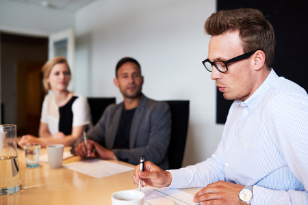 White male executive talking during meeting in conference room