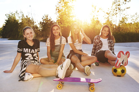 girl sit: Portrait of friends on a summer day in a park Stock Photo