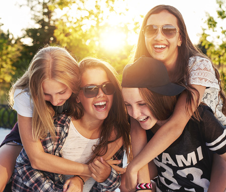 teen: Group of friends laughing and having fun Stock Photo