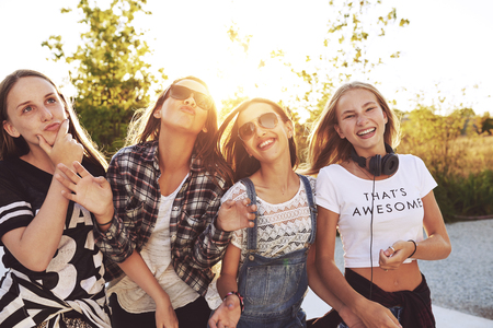 Teenagers having fun on a summer day, sun flare