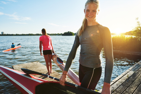 water sports: Fit woman with a kayak getting ready for practice