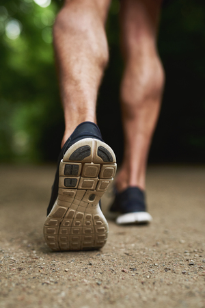 extremity: Close up Shoe Sole of an Athletic Young Man Running at the Park