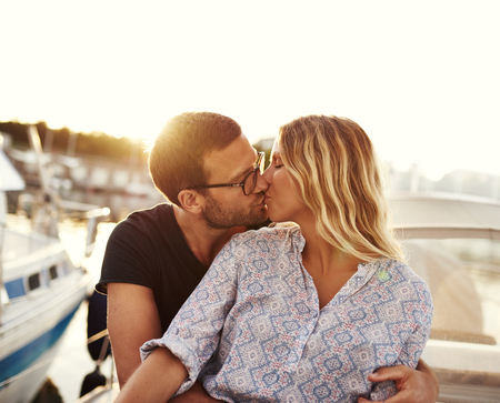 Man And Woman Kissing on a Boat, Sun Setting