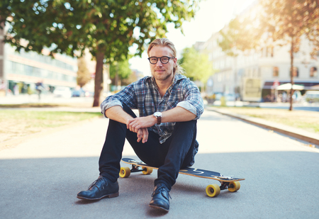 outdoors: Outdoor portrait of modern young man in the street Stock Photo