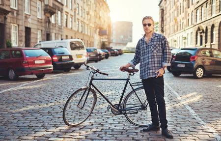 nonchalant: Man posing for camera, city lifestyle, cool stylish white man Stock Photo