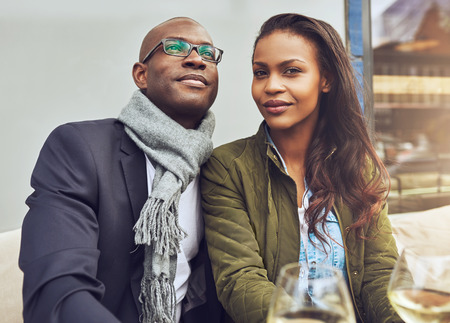 pensive man: Black couple enjoying life and dating, trendy dressed Stock Photo