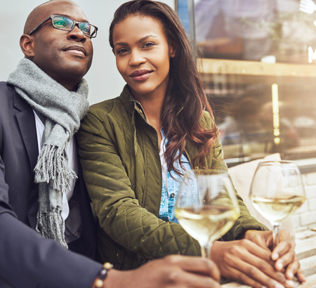 black couple: Afro american couple dating, woman looking straight at camera