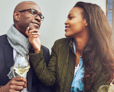 Black couple having a good time on a cafe in the spring Foto de archivo