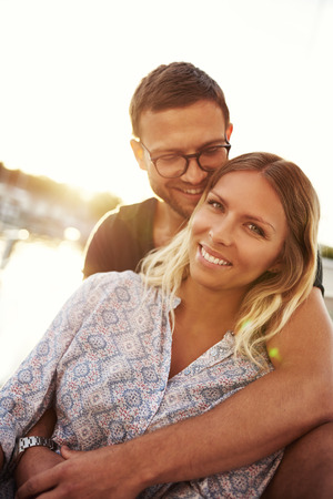 honeymooners: Close up, Man and Woman In Love By the Water Stock Photo