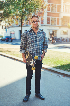 hair man: Hipster style portrait of young man. Stylish man with long blond hair Stock Photo