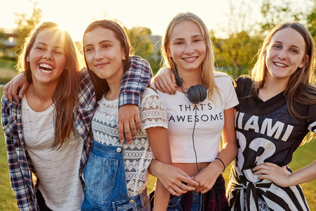 evening out: Group of teenage girls hanging out on a summer evening