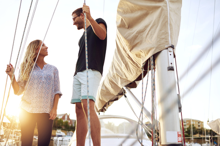 honeymooners: Couple Bought A Boat, Looking at each Other Satisfied