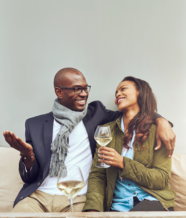 lighthearted: Afro american woman in love looking at her husband Stock Photo