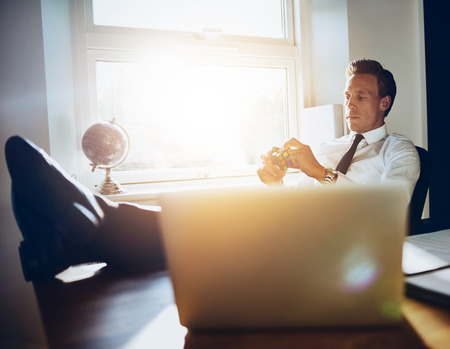 paralegal: White executive business man sitting at his desk getting inspiration and thinking